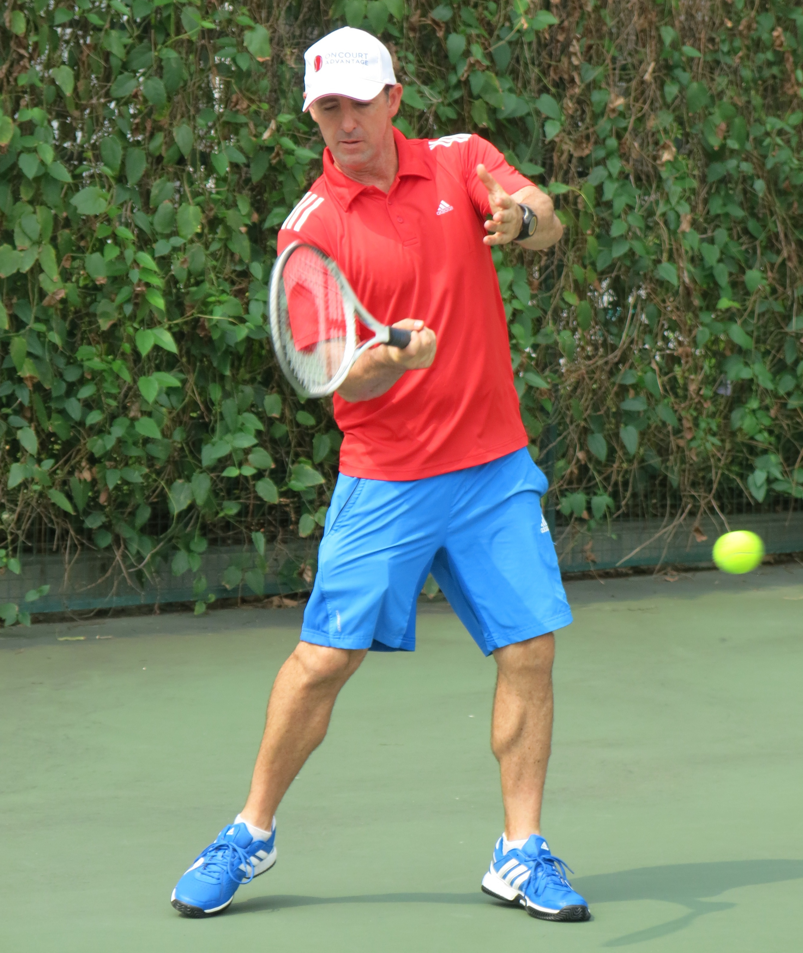 Tennis Lessons Singapore email info@oncourtadvantage.com or text +65 9830 2678 Jay smooth forehand after contact point
